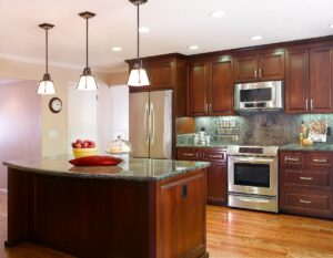 cherry cabintes, silver hardware, granite counter, island, recessed lighting, stainless steel applicances